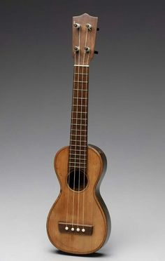 Cavaquinho    Jeronymo Jose Dos Santos, 1850–1900  Length 46.2 cm, width 12 cm (Length 18 3/16 in., width 4 3/4 in.)  Rosewood, spruce, walnut
