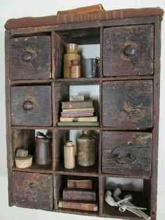 Love apothecary drawers <3 love the tiny collections of books