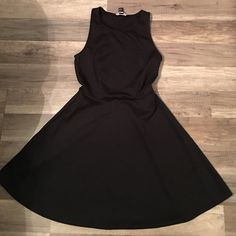 Forever 21 Little Black Dress Black sassy with a flare black Forever 21 dress so cute, dress it up with heels or casual with flats either way you look gorgeous 💕 Size Small Brand New Forever 21 Dresses Midi