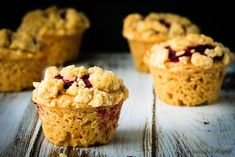 Amazing peanut butter and jelly muffins - light and fluffy peanut butter muffins with a homemade raspberry jam filling and a buttery crumb topping!