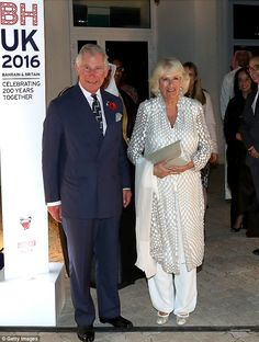 Prince Charles and the Duchess of Cornwall dressed up to attend an exhibition and receptio...