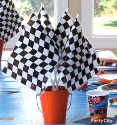 Waving a checkered flag marks a race's end, but this centerpiece means that the birthday fun is just beginning! Take a handful of checkered flags and place in an orange pail, and then you got the perfect finishing touch on a Hot Wheels celebratory spread!