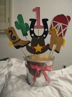 """Instead, use book characters.  could use raffia or """"rocks"""" in bucket.  Western Theme Centerpiece."""