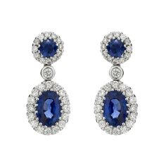 http://www.hemingjewels.com/product/sapphire-and-diamond-drop-earrings/3032/earrings/125/7  Sapphire and Diamond Drop Earrings Code - 00021062 A pair of sapphire and diamond drop earrings, a round and oval cut sapphire, with a combined weight of 1.38cts, each surrounded by round brilliant cut diamonds and adjoined by a single brilliant cut diamond, of 0.47ct total weight, all mounted in a fine 18ct white gold setting with post and scroll fittings. Price: £3,395