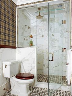 If showering is your go-to bathing option, forget about adding a tub. Instead, use what would have been the tub wall to create a spacious walk-in shower. Stretching across a bathroom's rear (and shortest wall), this walk-in shower provides plenty of pampering without overwhelming the small bathroom. Continuing the bathroom's marble walls and tiled flooring into the shower composes a cohesive scene that creates the perception of a larger space./