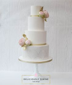 A four tier white, tall, elegant wedding cake with edible glitter and stencilled tier.  Caking it up stencil Harvest was used on a pearl lustre background.  Completed with handmade sugar peonies and buds, with gold leaves.  Sparkle tier using Magic Sparkles.