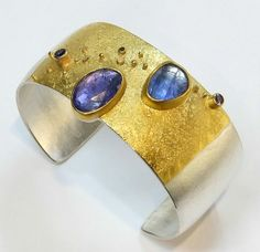 Rose cut tanzanites with faceted periwinkle-colored sapphires.  18k and 22k gold, silver www.sydneylynch.com