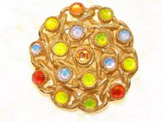 SARAH COVENTRY vintage BROOCH PIN. True vintage designer signed costume jewelry from the 1970's. Electric  neon faceted glass rhinestones. Wonderful piece.