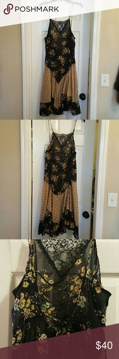 Free people flowy floral dress. Size M Free People long flowy floral dress. Laces up like a corset and ties down the back (pictured). Lace on top of front. Spaghetti straps criss cross on back. Can be tightened with corset like tie. Very sheer. Would have to be worn with a slip or something under it. Pictures do not do this dress Justice. It is stunning ?? Free People Dresses