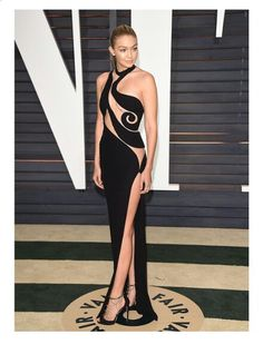 Gigi Hadid wearing an amazing black cut out Versace Dress at the Oscar's