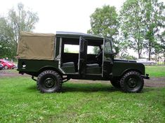 "Awesome Land Rover Series I 107"". I don't know if they every did a double cab pick up from the factory but its very cool."