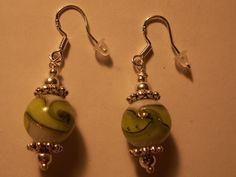 Green swirl earrings on sterling silver ear wires.