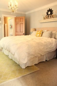 Like the big rug and the shelf accessories over the bed even though there is a headboard.