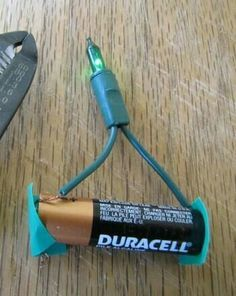 Who knew?! ...AA battery + Christmas light bulb + electrical tape = instant mini light :) Can be used in villages, wreaths, etc.