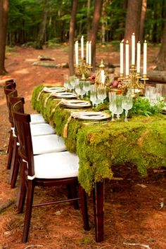 A woodland wedding with a moss table cloth inspired by Marie Antoinette.  Renewable tablecloth?  It certainly fulfills my desire for nature inspired linens!