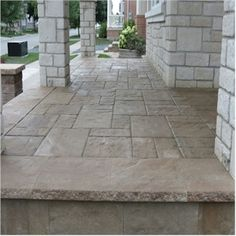 Resembles French Limestone. Stamped Concrete Porch Installation