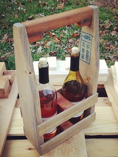 Wooden wine caddies that are made out of recycled wooden pallets. They are able to hold either 2 wine botttles, or 3!