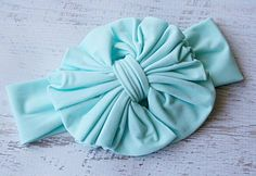 A #bigbow will offset the smaller prints on our Bora Bora Belly Shirt! #shopsmall #smallshop #handmade #hairbow #headband #bows #thebiggerthebowthebetterthemommy #ootd #hairaccessories #blue #babyblue #mint #aqua #styleboard