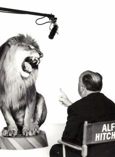 """Alfred Hitchcock directing the MGM lion, """"Leo."""""""