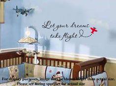 Let your dreams take flight Nursery Airplane VInyl Wall Lettering Decal. $19.99, via Etsy.