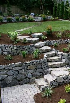 I like the stone stairs and the multi-level retaining wall/ shrub bed.