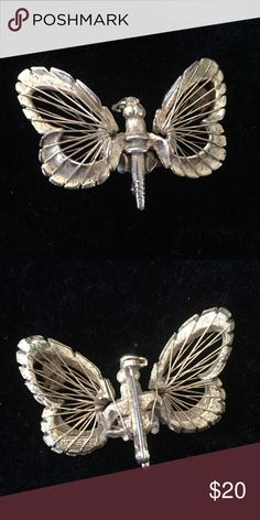 "Vintage 60's - 70's Butterfly Brooch This highly detailed gold-tone vintage butterfly has fine golden metal threads stretched over its wings. Measures 1-3/4"" x 1-1/2"". In excellent preowned vintage condition showing normal use and wear. It's just waiting to land on your outfit, whether it be a dress, lapel, purse or hat. Vintage Jewelry Brooches"