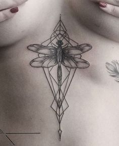 In awe of this dragonfly tattoo with geometric accents!