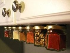 under the cabinet spices by robindu - another storage idea. Nail jar lids to a strip of wood and attach to underside of cabinet.