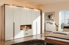 Modern Great Wood Finished White Painted Doors Wardrobe Design with Fancy Lighting #unique #interior #design // #interiordesign