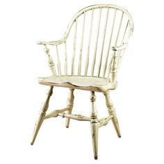 Add a cottage-chic touch to your dining room or eat in kitchen with this wood arm chair, featuring a classic spindle design and distressed ecru finish. ...