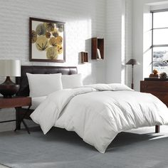 This cozy goose down comforter will keep you warm on even the coldest of nights. The boxed baffle keeps the down from migrating, and the comforter is completely hypoallergenic, which is ideal for allergy sufferers.