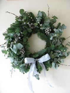 The Silver Wreath; pussy willow, eucalyptus, and thistles, with a silver ribbon, for a winter wonderland look.