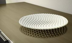 The ORB tray consists of many small orbital shapes that have been deformed and together creates a whole.