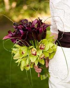 Lovely unusual bouquet of calla lilies and cymbidium orchids.  Striking split of colour