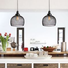 This round, mesh cage pendant is our contemporary take on a classic, industrial fixture. Features a sleek, black metal cage frame that reveals the warm glow from a vintage-inspired Edison bulb. Striking in an office, a hallway, or in multiples over a kitchen island.