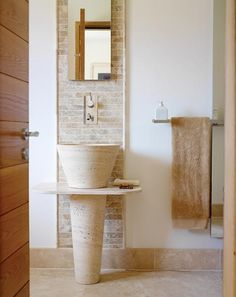 Another interesting possibility: A long wide strip of tiles on the sink wall, behind the sink and mirror, but then leave the rest of the wall untiled.