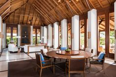 Vaulted wooden ceiling living and dining room room, Amanyara Villas