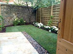 diseño para jardín con muro de piedra