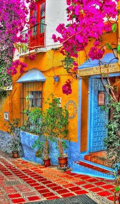 I love the stunning colours on this building. [Credit: Restorante El Pozo Viejo in Marbella, Spain Beautiful World, Beautiful Places, Beautiful Streets, Wonderful Places, The Places Youll Go, Places To Go, Colourful Buildings, Colorful Houses, Colourful Garden