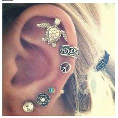 OMG ! I kinda want this know, but it's like 3 to many piercings. I love the turtle !