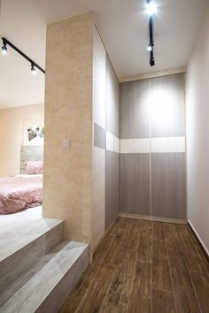 8 Ways to Squeeze a Walk-in Wardrobe in Your HDB Bedroom: A platform lends a more exclusive closet, while also helping to create a cosier enclave in the sleeping quarters. Platform Bedroom, Bedroom Loft, Home Decor Bedroom, Bedroom Furniture, Furniture Sets, Walk In Wardrobe, Bedroom Wardrobe, Contemporary Bedroom, Modern Bedroom