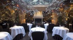 Clos Maggiore the most romantic French restaurant in London, cosy dinning area surrounded by flowers with skylight and fireplace French Restaurants, London Restaurants, Ivy Market Grill, Dating In London, Outdoor Restaurant, Online Restaurant, Restaurant Ideas, Romantic Meals, Dinner Club