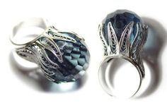 A dramatic oversize cocktail ring from Yvone Christa with a faceted domed blue stone