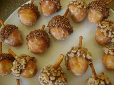 Donut holes, nutella or frosting, sprinkles or walnuts, pretzel stick
