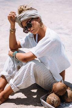 Go Boho with a head wrap, a plain white tee and accessories.