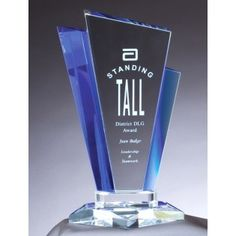 """Peerless Glass Trophy features unique shaped glass piece with blue highlights and a clear base. Item comes in a deluxe gift box and 3 sizes to choose from:  GL123 = 4.75"""" x 8.25"""", GL124 = 5.5"""" x 8.75"""" & GL125 = 6.25"""" x 10"""" Size."""