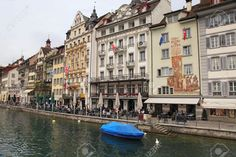 24518713-LUCERNE-SWITZERLAND-MAY-06-Famous-hotels-shops-and-outdoor-cafe-on-waterfront-of-Reuss-river-in-Old--Stock-Photo.jpg (1300×866)