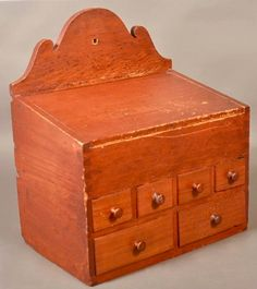 "Conestoga 10/1/16 lot 225. Estimate: $ 800 - 1,200. Realized: $786 (650). Desc:  Good Pennsylvania 19th Century Mixed Wood Hanging Spice Box. Arched and scrolled backboard with hanging eyelet, slant hinged lid with compartmented interior, dovetailed case, four over two drawer configuration. 20-1/2""h. x 17-3/4""w. x 11-1/2""d. Condition: Good with minor breaks and wear."