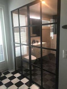 Room divider with steel framed glass doors.