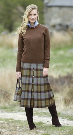 -tailored skirt with sweater and blouse in colors found in the plaid. Looks warm and wonderful.